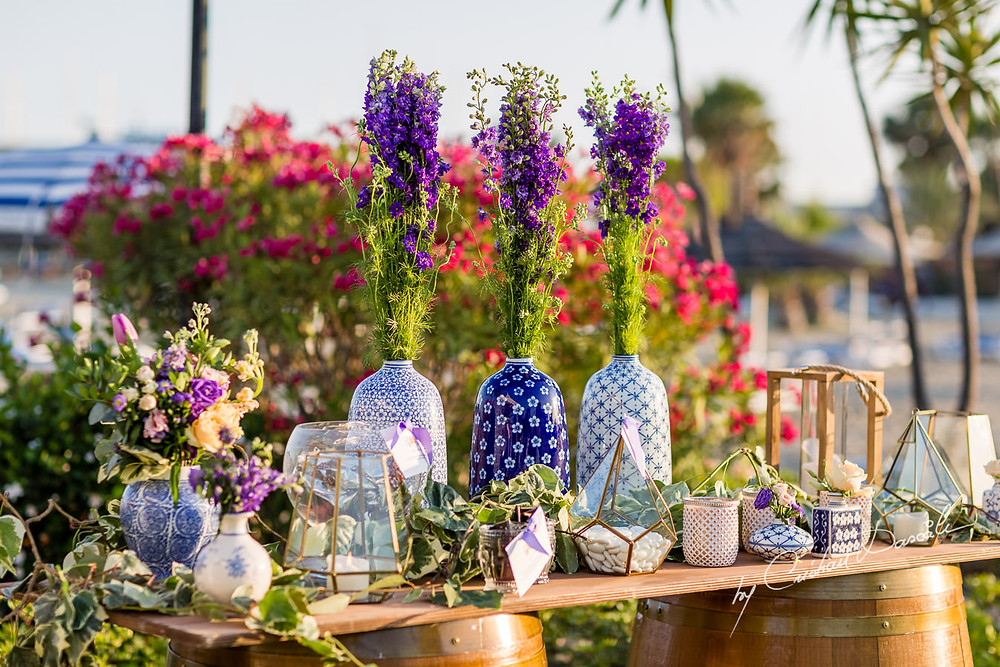 Chinese vases stood next to geometric lamps and filled with lilac and pastel blooms