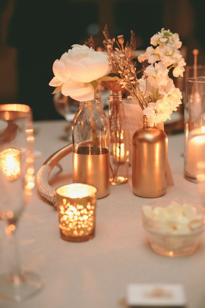 Candles and gold painted vases
