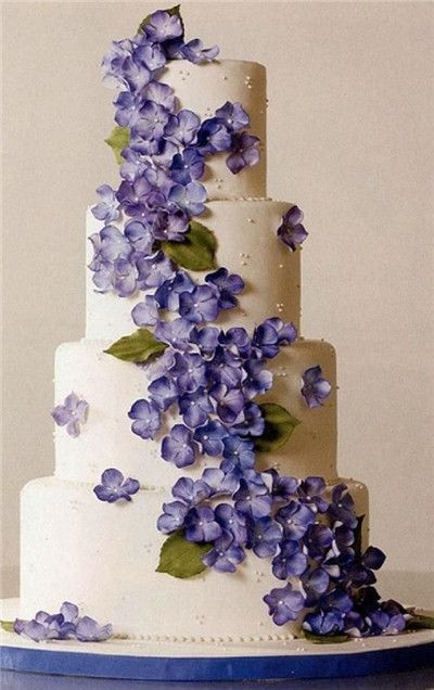 Ultra violet wedding cake fresh flowers