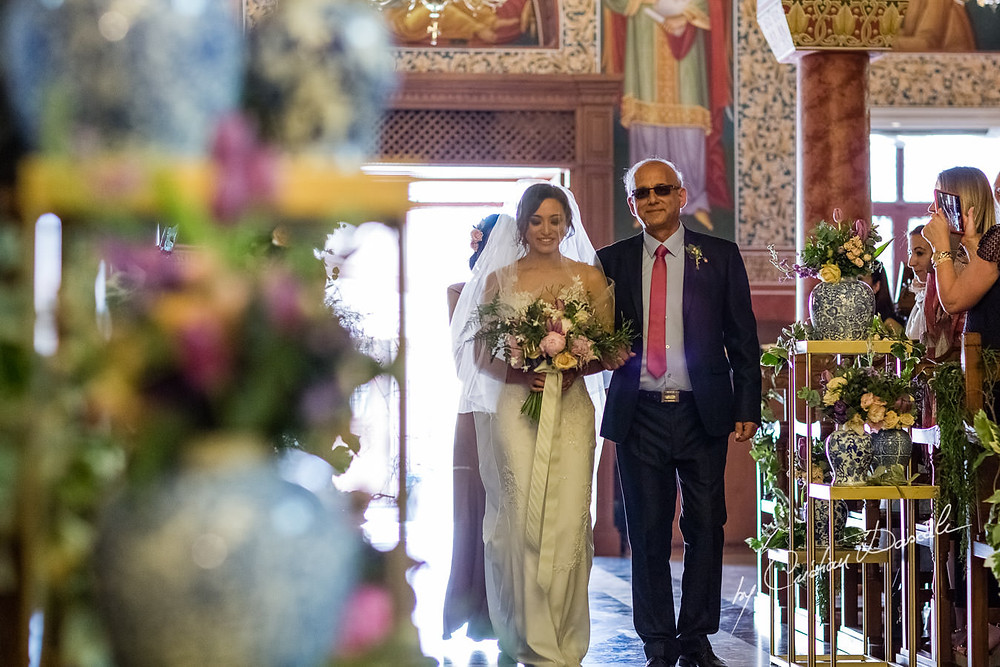 Walking down the aisle is not typical in Greek Orthodox weddings