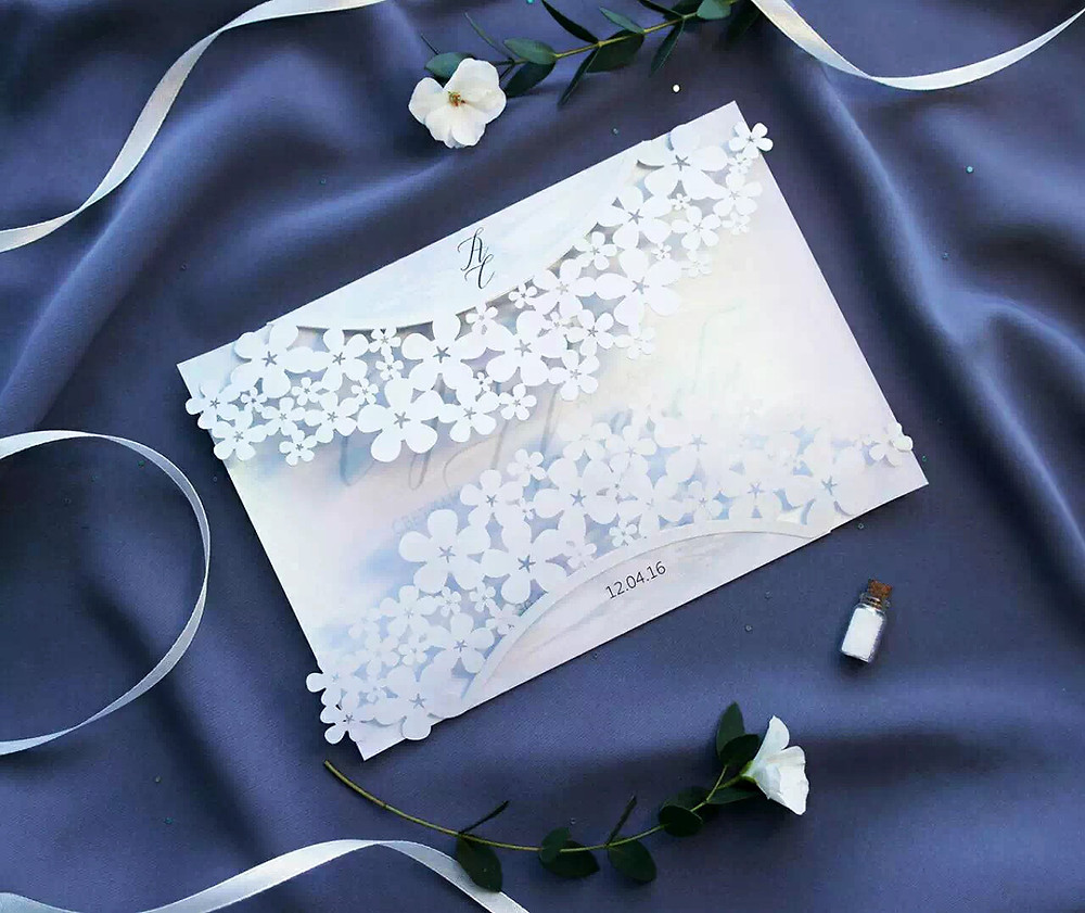 Laser cut designs on pearl white cardstock