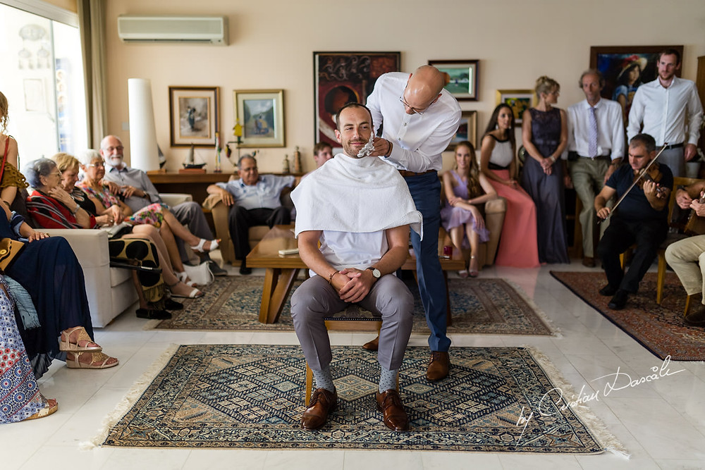 The best man and brother shaves the groom as part of his stolisma