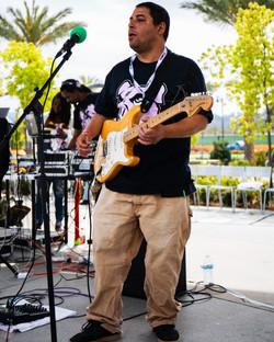 Timi Hen on guitar