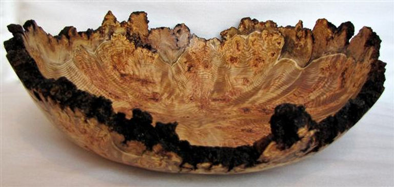Highly figured large apen burl bowl with dramatic bark edge