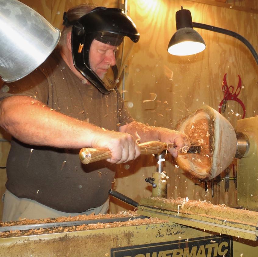 Joe turning a honey locast bowl