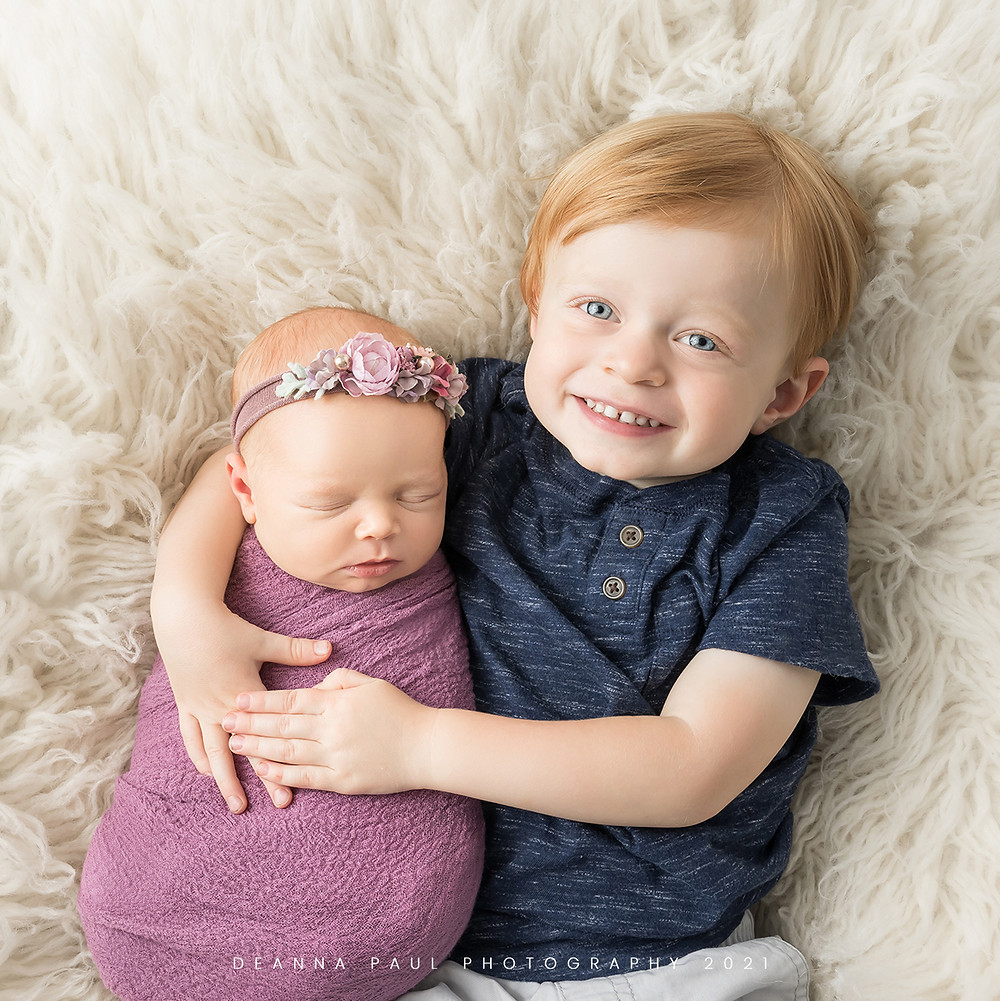 newborn with sibling boy and girl