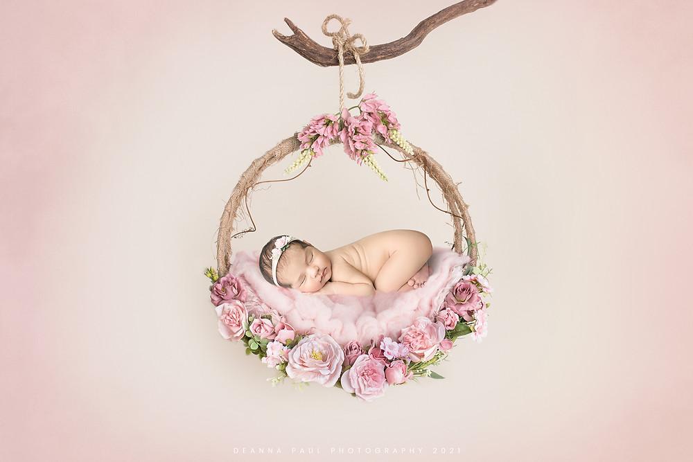 newborn baby girl photo wreath hanging pink flowers