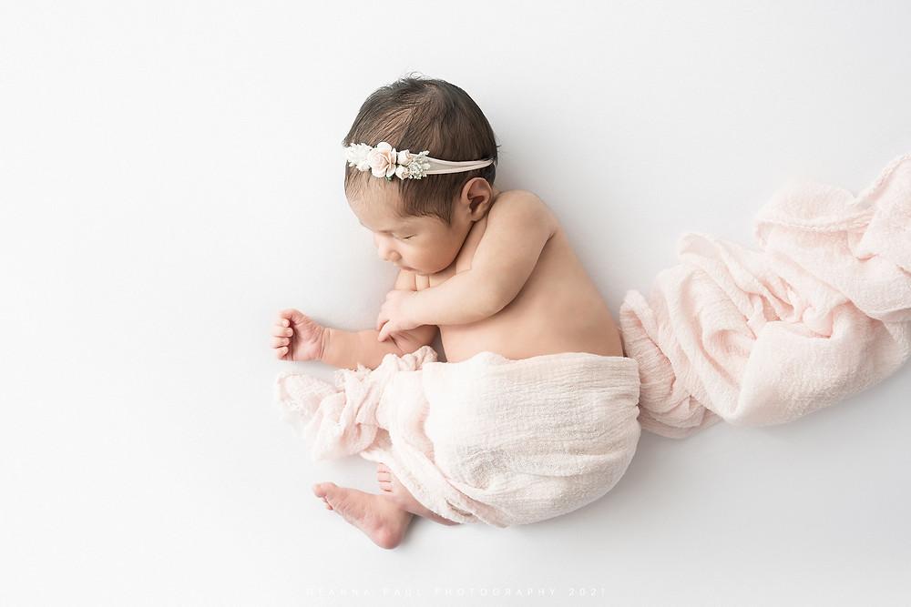 newborn baby girl baby led pose wrap pink headband