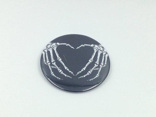 Skeletal hand pocket mirror