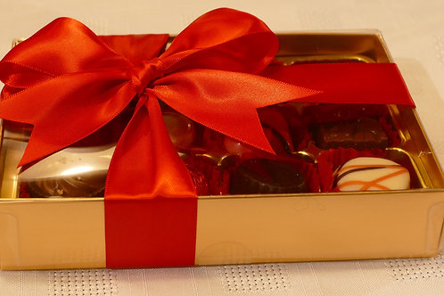 12 Valentino chocolates in gold box with clear lid