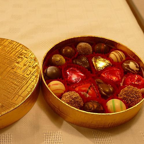 Round Gold box filled with 18 Valentino chocolates