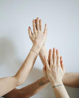 women-touching-hands-3735476.jpg