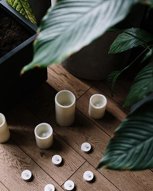 four-white-ceramic-mugs-on-brown-wooden-