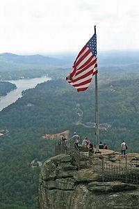 American flag shown at peak of Chimney Rock, NC