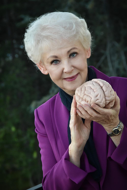 Arlene R. Taylor PhD holding a brain