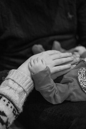Mother, father and daughters hands