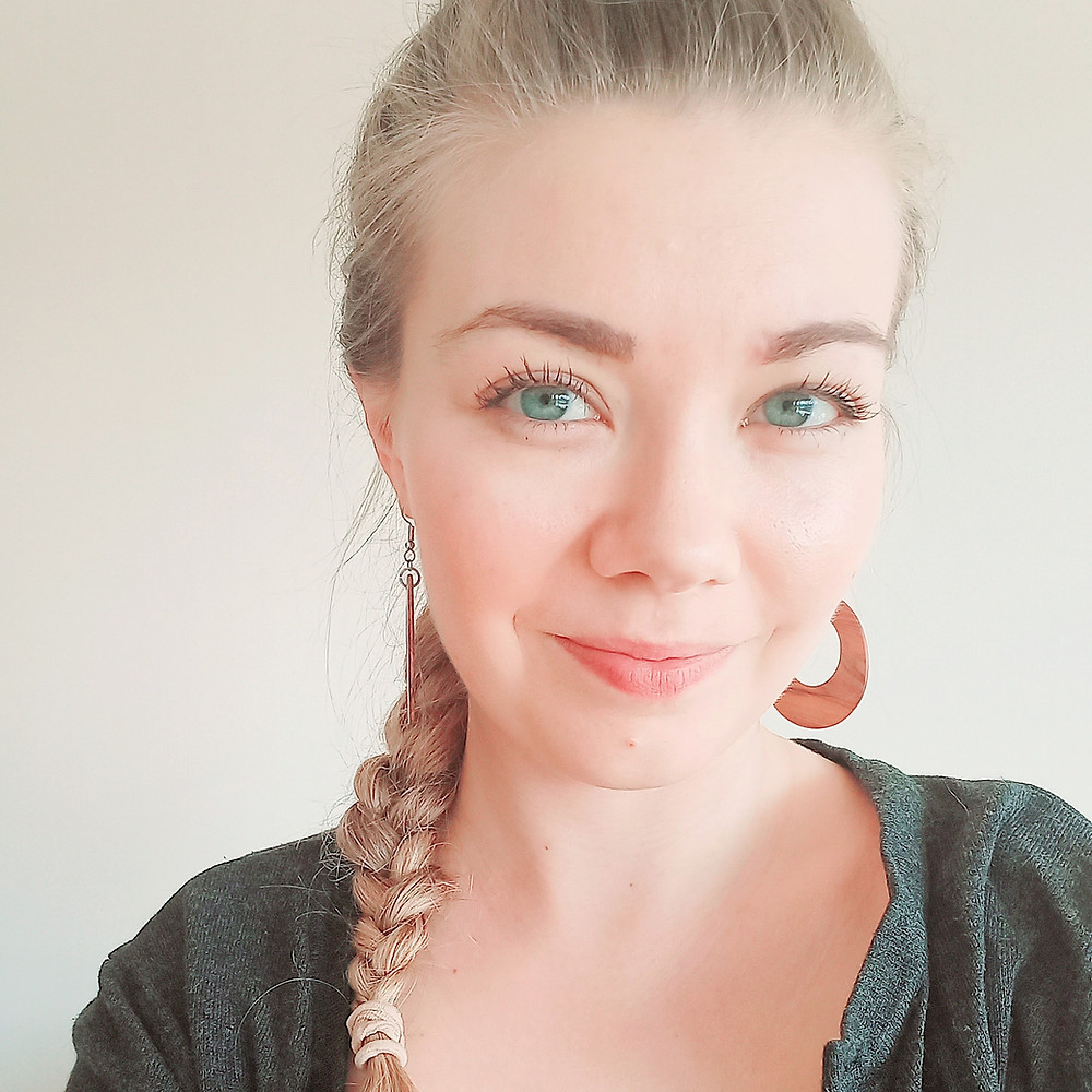 Girl with a plait and wooden earrings