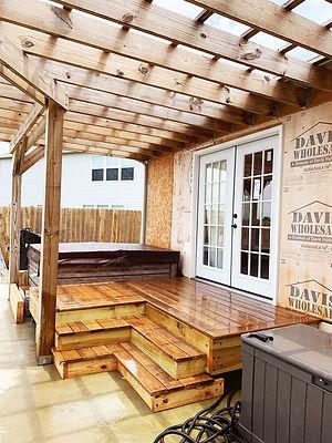 Construction on a backyard deck & house siding install