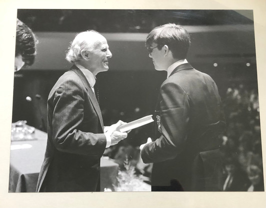 Receiving a prize from Sir David Willcocks