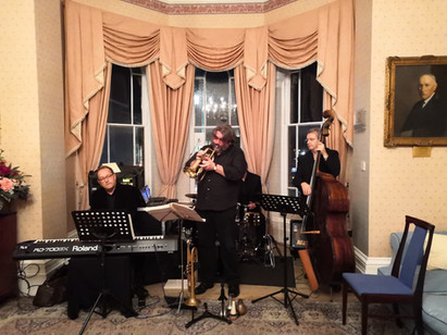 Jazz gig at a function, with Anton Gwilt (piano), Julian Braun (drums), and Jim Pullen (bass)