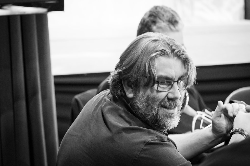 Black and white image of Mark Cox in rehearsal