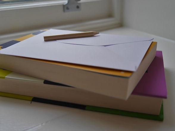 letter-on-top-of-books.jpg
