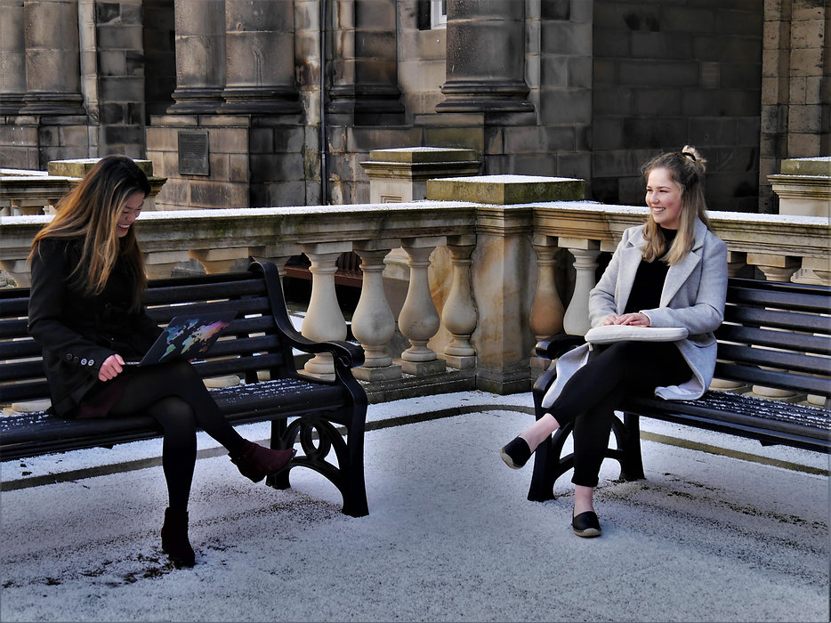 edinburgh-old-college-students-sat-on-be