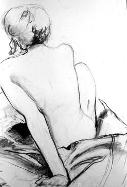 back of sitting figure