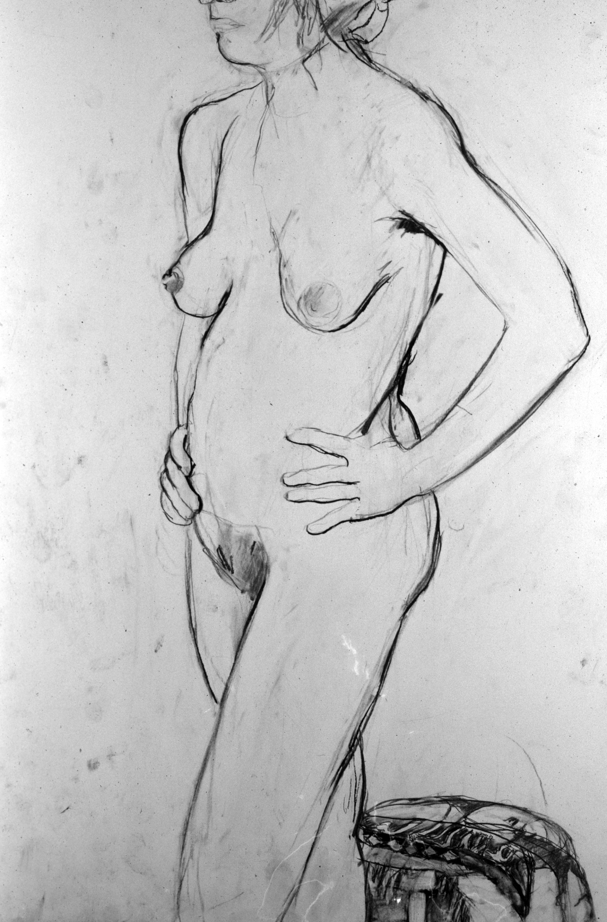 nude figure w hands on hips