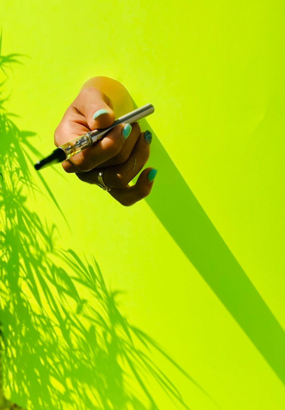 cannabis vape cart hand
