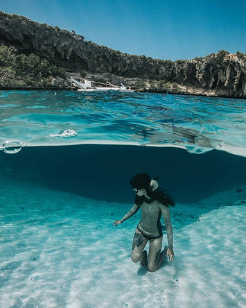 Competitive freediver Kristin Kuba dives deans blue hole