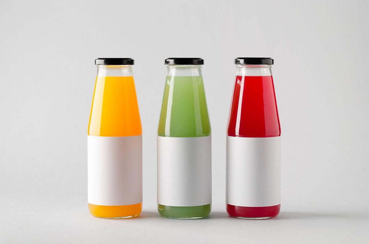 Juice Bottle Mock-Up - Three Bottles. Bl