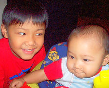 Siblings play together at Happy Kds Family Day Care setting