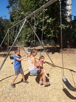 One of the HUSH families playing at a playground