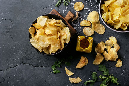Bowl of home made potato chips served wi