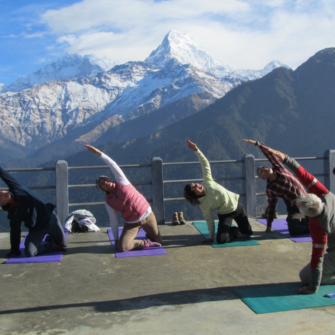 Yoga run by Lou Nulley from Yoga Pathways, Canberra - An Annual REACH for Nepal Community Rebuild Trip organised by Nepal Adventures. Backdrop - The Annapurna Ranges