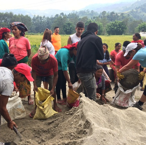 Locals and Volunteers at work at a REACH for Nepal project site