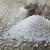 a-pile-of-sea-salt-on-a-weathered-wooden