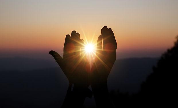 spiritual-prayer-hands-over-sun-shine-wi