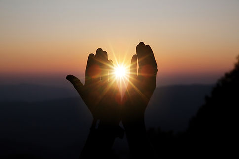 spiritual-prayer-hands-over-sun-shine-with-blurred-beautiful-sunset.jpg