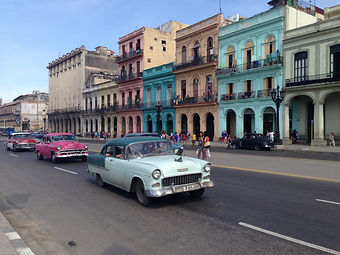Classic cars driving in old Havana
