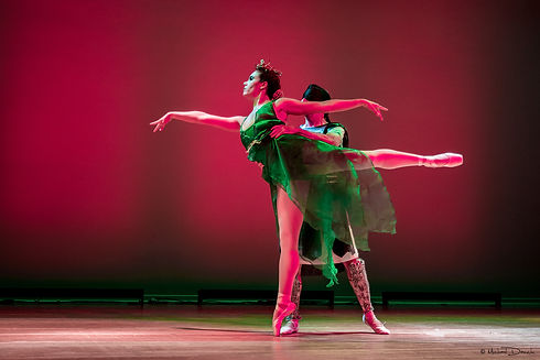 A ballet dancer on pointe in arabesque dancing a duet