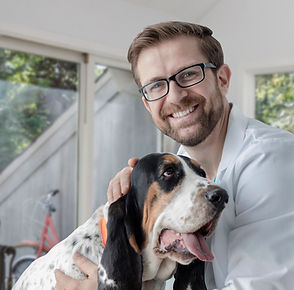 doctor posing with dog smiling