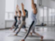 yoga-group-classes-inside-gym_1303-14780