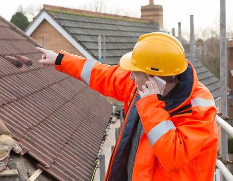 Surveyor on roof.jpg