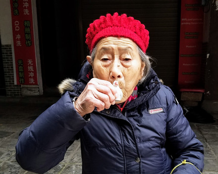 Chinese lady blowing whistle