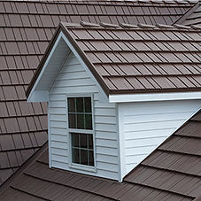 Metal shingles on a roof and dormer