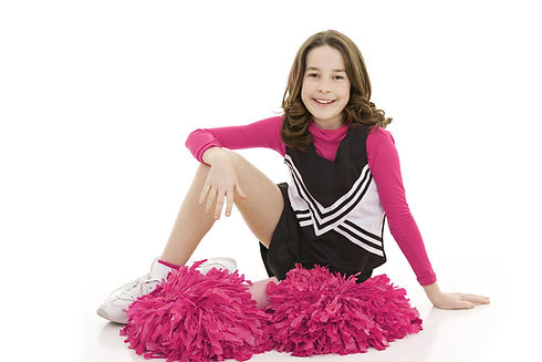 Girl cheerleader sitting on floor with pink pom-poms