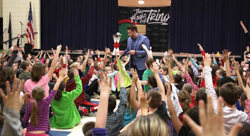 Trino performs magic at school assembly