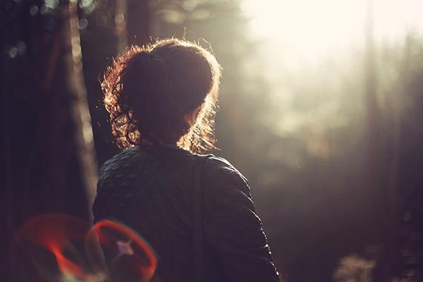 Woman Facing Sunrise